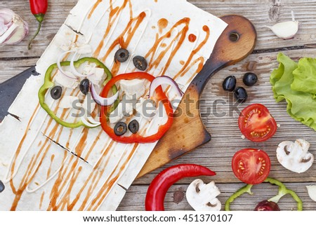 Healthy lunch snack. Tortilla wraps with grilled chicken fillet and fresh vegetables on wooden background. Top view - stock photo