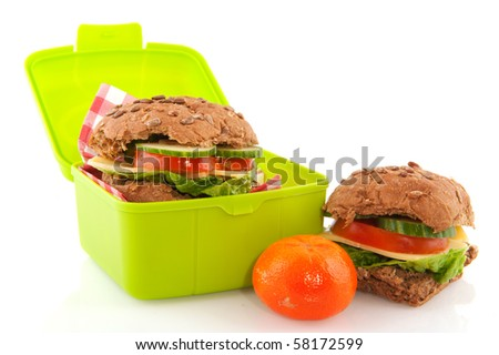Healthy lunch with whole meal bread rolls milk and fruit - stock photo