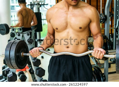 Healthy man Reverse Barbell Curl  - stock photo