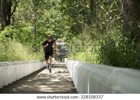 Healthy man running upstairs.Training for strength. - stock photo