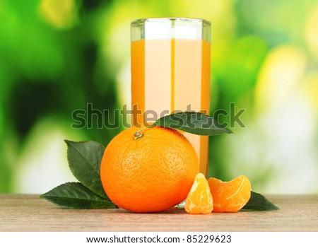 Healthy mandarin juice on wooden table - stock photo
