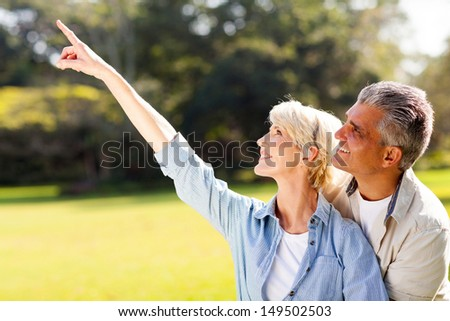 healthy mature couple relaxing outdoors - stock photo