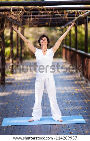 healthy middle aged woman arms reach out - stock photo