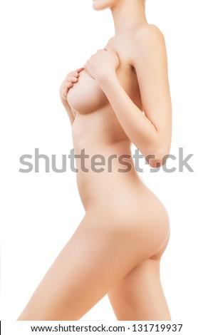 healthy naked girl with hands on breasts on white background - stock photo