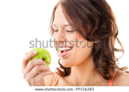 Healthy nutrition and healthy teeth or diet, young woman bites in a fresh apple - stock photo