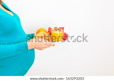 healthy nutrition and pregnancy. pregnant woman's belly and healthy food - stock photo
