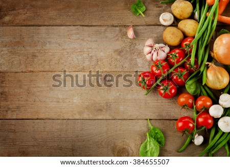 Healthy organic foods on wooden background. Top view - stock photo