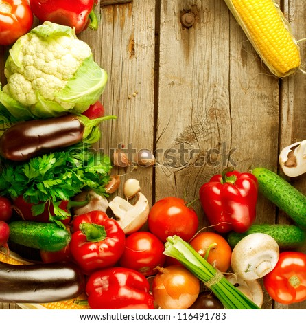 Healthy Organic Vegetables on a Wooden Background. Frame Design - stock photo