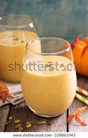 Healthy pumpkin smoothie with chia seed in glasses on rustic background - stock photo