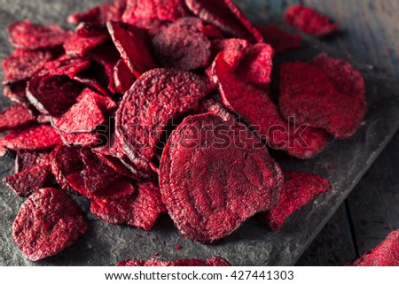 Healthy Purple Baked Beet Chips with Sea Salt - stock photo
