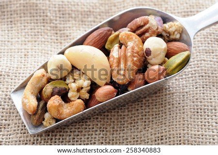 healthy roasted nuts in spoon display at market place - stock photo