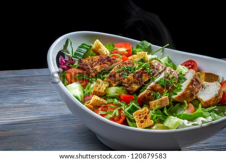 Healthy salad made of vegetables and chicken - stock photo