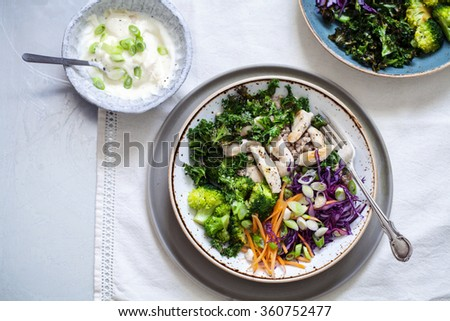 Healthy salad with buckwheat, chicken, broccoli, crispy kale and red cabbage - stock photo