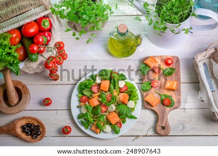Healthy salad with fresh vegetables and salmon - stock photo
