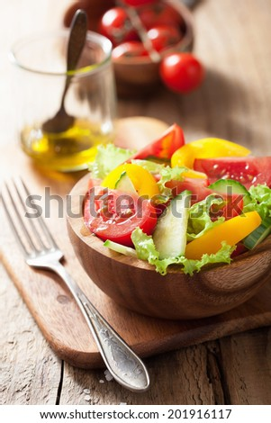 healthy salad with tomatoes cucumber and pepper - stock photo