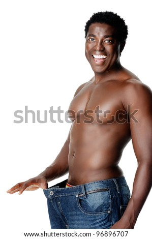Healthy slim man shows off his thin waistline after some dieting and weightloss. healthy lifestyle black african man - stock photo