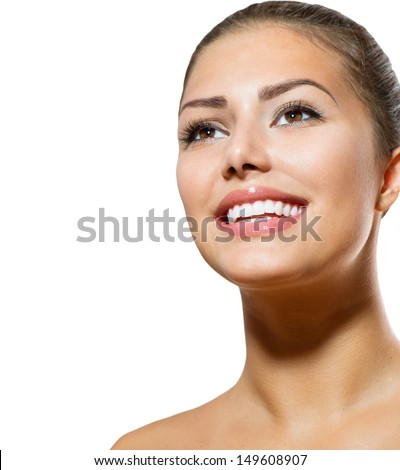 Healthy Smile. Teeth Whitening. Beautiful Smiling Young Woman Portrait. Over White background . Laughing Girl - stock photo