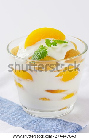 healthy snack consists of plain yogurt with fresh peaches - stock photo