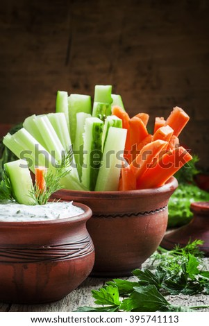 Healthy snacks: celery, cucumber and carrot, sliced, sauce, Greek yogurt and garlic, diet, selective focus - stock photo