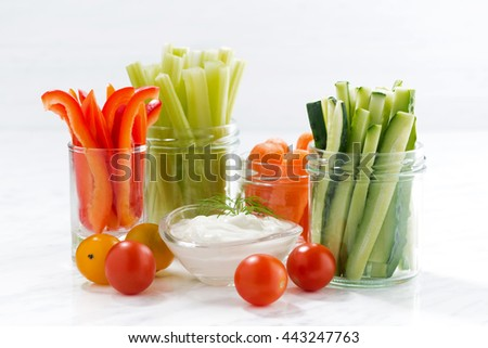 healthy snacks, mixed vegetables and yogurt on a white background, closeup - stock photo