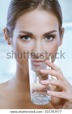 Healthy sport woman drinks cold water from glass - stock photo
