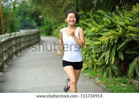 healthy sports woman runner running at park - stock photo