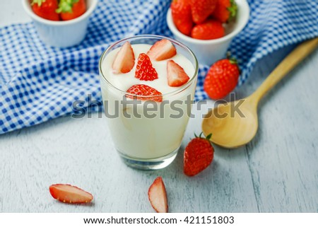 Healthy strawberry yogurt, Delicious refreshing glass of ripe red fresh strawberries and cream or creamy yoghurt garnished for a tasty dessert - stock photo