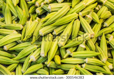Healthy super food vegetable okra on an open air fruit market stand - stock photo