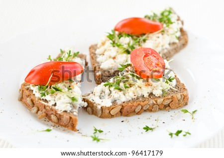healthy tasty organic granary bread with cream cheese - stock photo