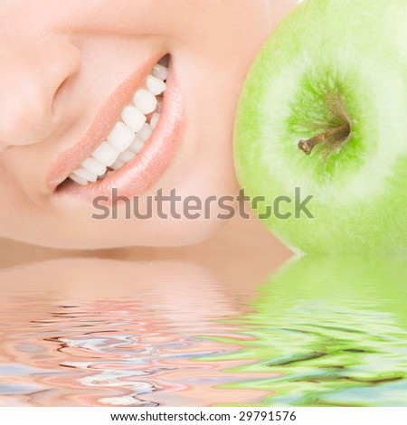 healthy teeth and green apple - stock photo