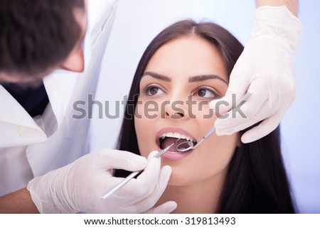 Healthy teeth patient at dentist office dental caries prevention - stock photo