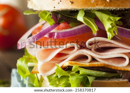 Healthy Turkey Sandwich on a Bagel with Lettuce and Tomato - stock photo