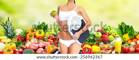 Healthy vegan diet. Beautiful woman with scales. - stock photo