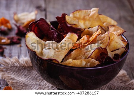 Healthy vegetable beetroot, sweet potato and white sweet potato chips on a bowl close up. Selective focus - stock photo