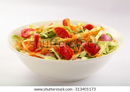 Healthy vegetable salad with cabbage,tomato ,carrots,cucumber,lettuce and spices. - stock photo