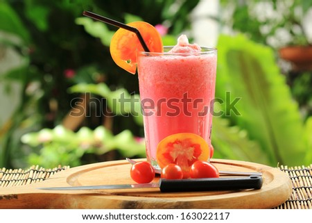 Healthy vegetable smoothie made of red ripe tomatoes smoothies - stock photo