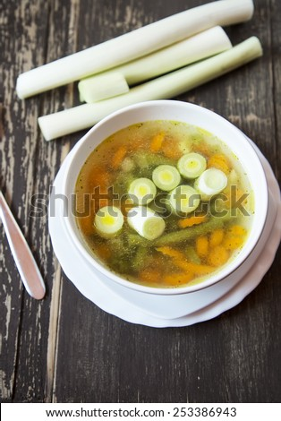 Healthy Vegetables and Leek Soup on Wooden Board - stock photo
