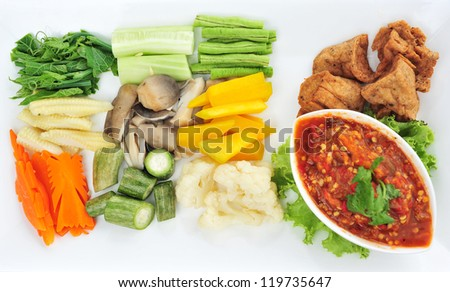 Healthy vegetables dipped in sauce - stock photo