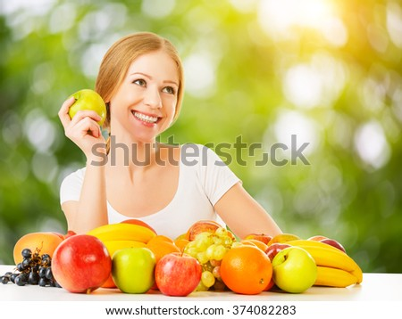 healthy vegetarian food. happy woman eating apple and fruit  in the summer - stock photo