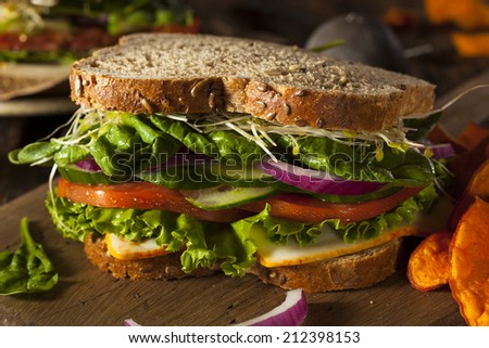 Healthy Vegetarian Veggie Sandwich with Spinach Tomato Cucumber - stock photo