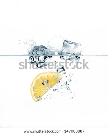 Healthy Water with Lemon and Ice Cube - stock photo