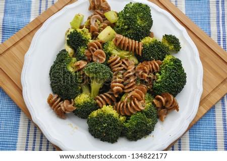 Healthy whole grain pasta with broccoli - stock photo