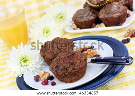 Healthy, wholesome whole wheat Morning Glory muffins. - stock photo