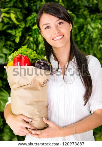 Healthy woman buying fresh food at the local market - stock photo