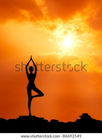 healthy woman  practice yoga at sunset silhouetted - stock photo