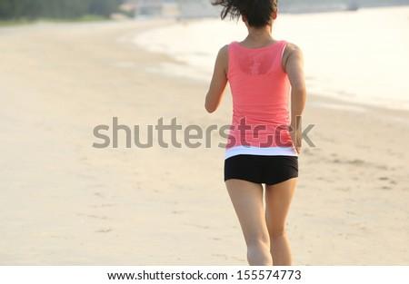 healthy woman runner at beach - stock photo