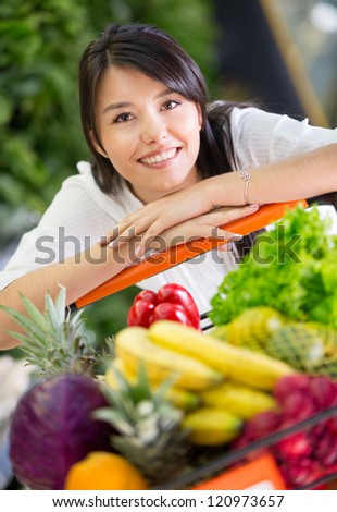 Healthy woman shopping for groceries at the supermarket - stock photo