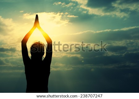 healthy yoga woman meditation at sunrise seaside - stock photo