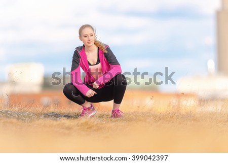 Healthy young woman before running in city park. - stock photo