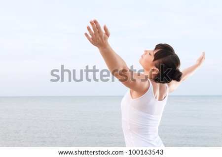 Healthy young woman breathing and enjoy the summer breeze outdoor at sea - stock photo